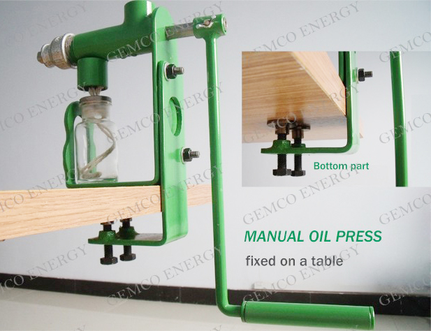 manunal oil press fixed on a table